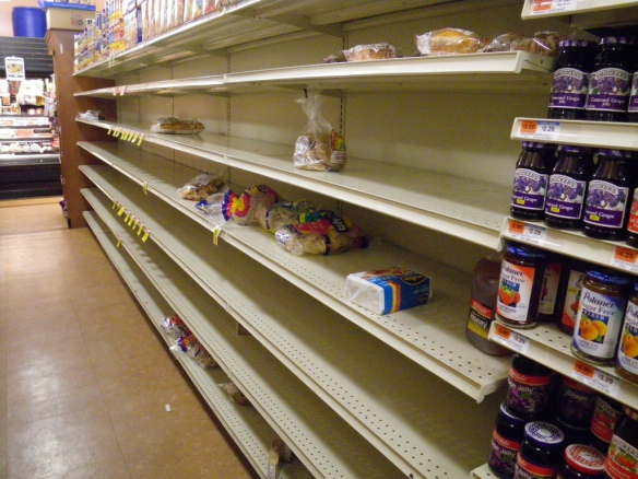 Empty shelves from the bread section of a supermarket - Flickr.