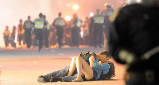 Vancouver Riots 2011 - Couple kissing on ground