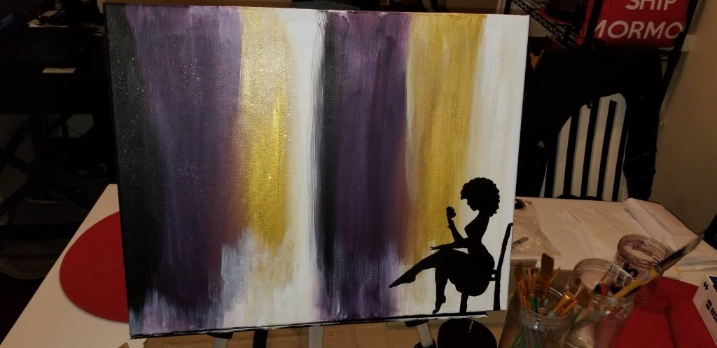 Incomplete art project: black silhouette of a seated woman against an abstract purple, gold and white background